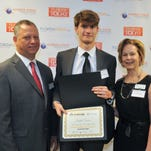 Student Joseph Crown of West Shore Jr./Sr. high school poses with Jeff Kiel, FLORIDA TODAY president and CEO, and Kathy Cobb, associate vice president of academic programs at EFSC.