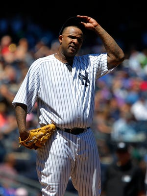 May 23, 2015; Bronx, NY, USA; New York Yankees starting pitcher CC Sabathia (52) reacts after giving up a hit in the third inning against the Texas Rangers at Yankee Stadium. Mandatory Credit: Noah K. Murray-USA TODAY Sports