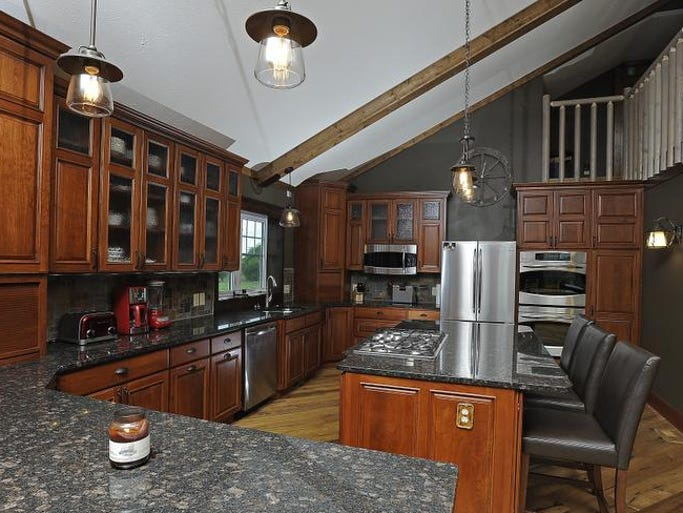 This kitchen includes cabinets found at an 80 percent discount at Habitat for Humanity ReStore. The custom-designed cabinets were delivered in a wrong finish and donated to ReStore.