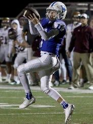 Windthorst quarterback Hunter Wolf makes a catch Thursday,