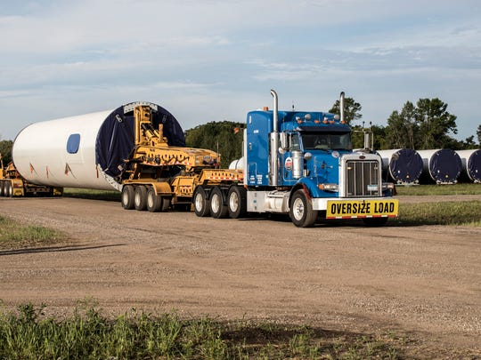 Pictured is an ATS truck hauling a tower section, one of eight or nine components that make up a complete wind turbine.