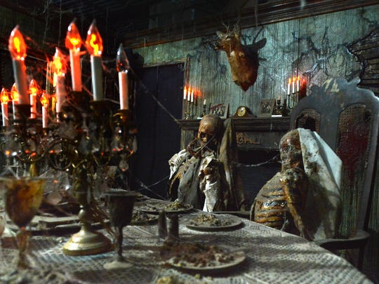 Dinner is served in the dining room of the classic Victorian house area of the Reign of Terror haunted house at the Janss Marketplace in Thousand Oaks.
