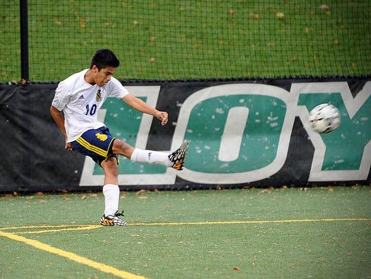 Pocomoke's Gustavo Enriquez fires a corner kick during