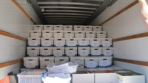Boxes filled with gambling petition signatures sit