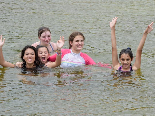 Hayley, Xiomara, Marina, Sadie and Melisa enjoy swimming