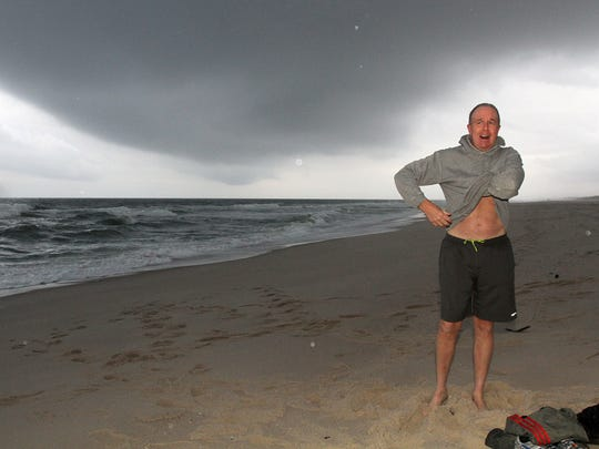 Island Heights resident Doug Maday prepares to take a swim along the Seaside Park shoreline late last Friday afternoon.