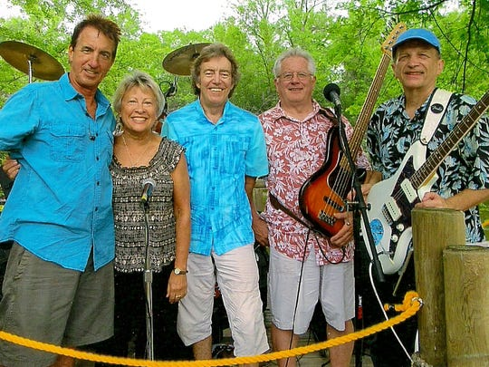 Canoise is made up of, left to right, Larry Suess, Sue Newton, Pat Curto, Neal Dunning and Bob Coates.