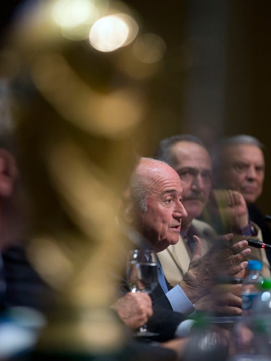 FIFA President Sepp Blatter speaks, as Brazil's Sports Minister Aldo Rebelo, center, looks on, during a press conference, where they talked about the organization and infrastructure of the upcoming World Cup, in Sao Paulo, Brazil, Thursday, June 5, 2014. The World Cup soccer tournament starts on 12 June. (AP Photo/Andre Penner)