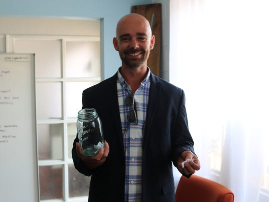 Michael Wilson, lead alcohol and drug counselor at CHOICES Behavioral Health Care, often has clients select an inspirational quote from a jar during group therapy sessions.