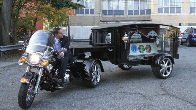 Matt Fiorillo, owner of Ballard-Durand Funeral Home in White Plains, drives the new motorcycle hearse that the company purchased in the funeral home parking lot Oct. 3, 2014.