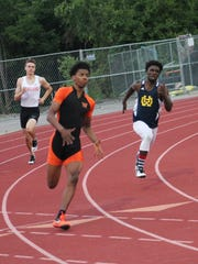 Withrow's Amir Willis has an edge on Robvae McDonald of Walnut Hills in the 200 meters at the ECC meet May 10.