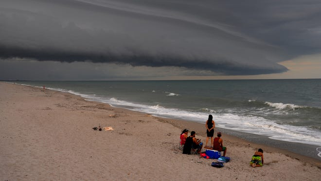 Storm clouds roll in over the ocean as seen from Patrick Beach at Patrick Air Force Base earlier in June.
