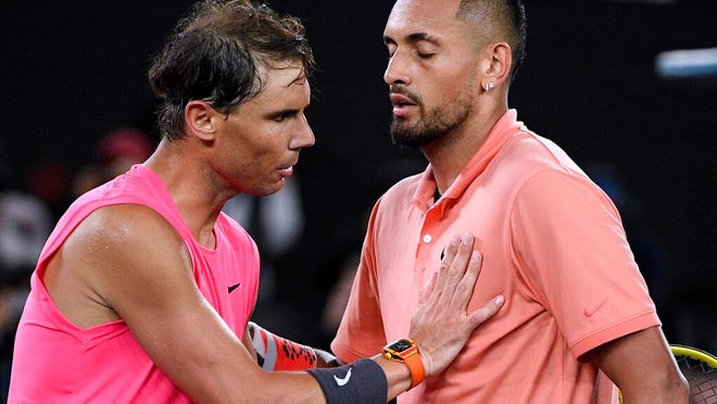 Spain's Rafael Nadal, left, is congratulated by Australia's Nick Kyrgios after winning their fourth round singles match at the Australian Open tennis championship in Melbourne, Australia, Monday, Jan. 27, 2020.