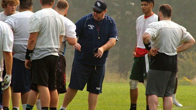 Former College of the Siskiyous football coach Charlie Roche - who this year, takes over as the school's athletic director - talks to players in the fall of 2019. This year's season will look a little different, as all fall and spring sports will be played in the spring of 2021 due to the COVID-19 pandemic.