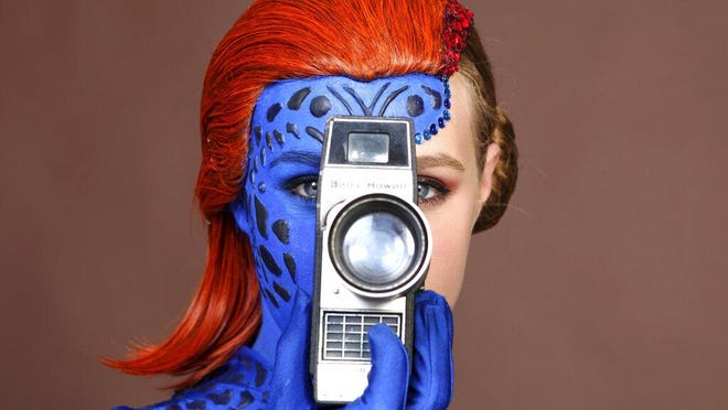 Evy Thomas, dressed as Mystique, poses for a portrait on day one of Comic-Con International on Thursday, July 18, 2019, in San Diego.