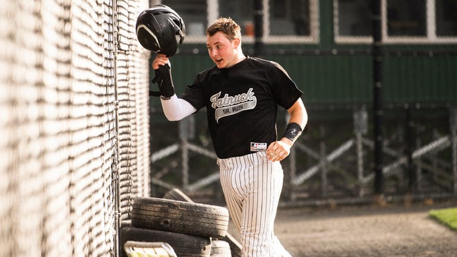 Tatnuck's Andrew Lebreck returns to the dugout after scoring against Holden in a Paul N. Johnson Senior Ruth game last week at Worcester State.