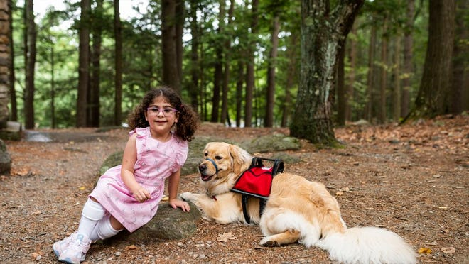 Kristiana Cake has more confidence, and her mom, Kimberly more peace of mind, since welcoming service dog Matti into their family this spring.