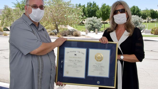 Joan Johnson, Naval Air Warfare Center Weapons Division's executive director, presents Tony Shepherd with a 40-year length of service award during a presentation July 29 at China Lake.