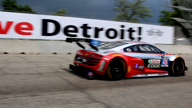 The race car of co-drivers Christopher Haase and Dion Von Moltke with Paul Miller Racing head past turn two onto the main straight as threatening clouds of rain and cold winds surround them in the Chevrolet Sports Car Classic of the Tudor United SportsCar Championship on Belle Isle in Detroit, Michigan on Saturday, May 30, 2015.