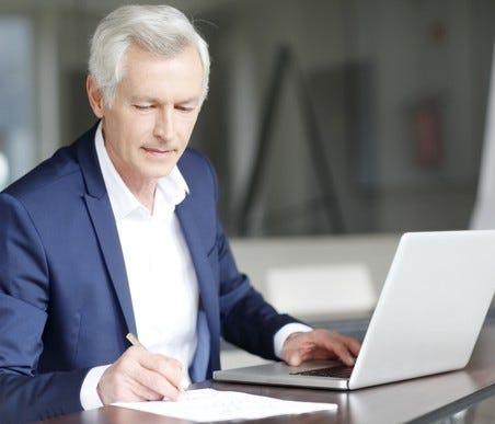Older man working at a laptop