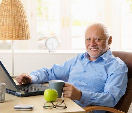 Smiling older man at desk