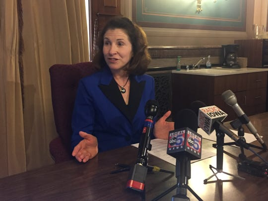 State Auditor Mary Mosiman talks with reporters Monday