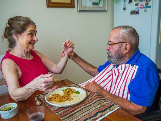 Linda Ragsdale, 75, talks to her husband George Otto,