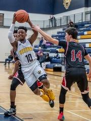 Battle Creek Central's Joshua Mann goes for the hoop