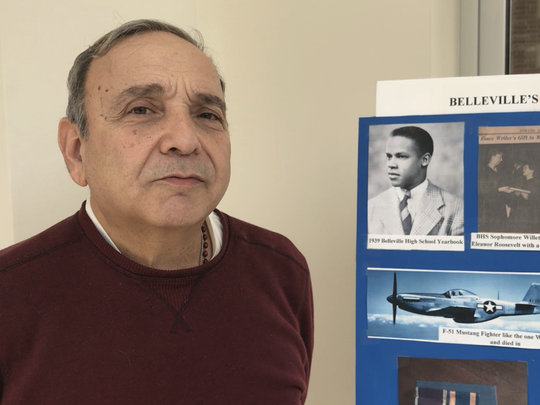 Belleville Township Historian Michael Perrone discusses the life of Tuskegee Airman Lt. Leonard Willette, of Belleville, while standing next to a display in the airman's honor at the Belleville Public Library on Tuesday, Feb. 20, 2018.
