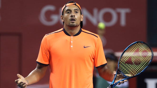 Australia's Nick Kyrgios reacts after getting a point against Gael Monfils of France during the semifinal match of Japan Open tennis championships in Tokyo.