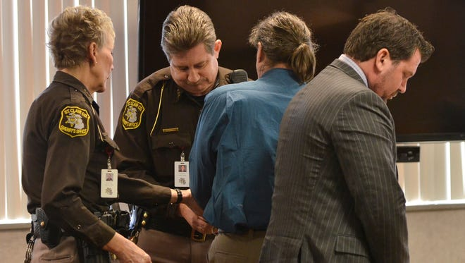 St. Clair County deputies place handcuffs on Jess Bowman, 52, after a guilty verdict for the Aug. 6 murder of Timothy Belisle in Americana Estates mobile home community in Casco Township. Bowman was found guilty of felony firearm and 2nd degree murder.