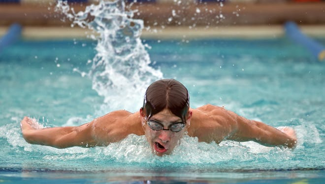 Clinton native Blaise Vera, 16, swims during training in Flowood Thursday.