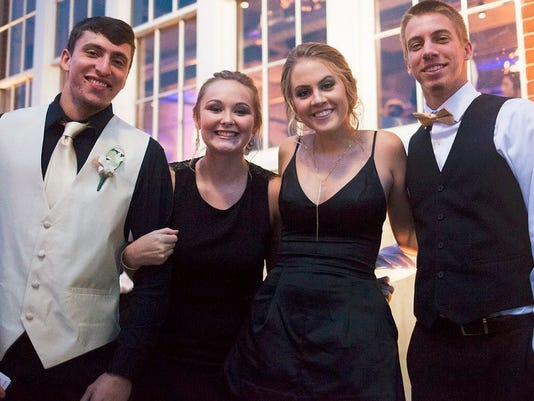 Students pose before the York Suburban homecoming dance.