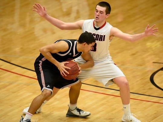 Monticello's Isaiah Wills tries to get past Jon Olson
