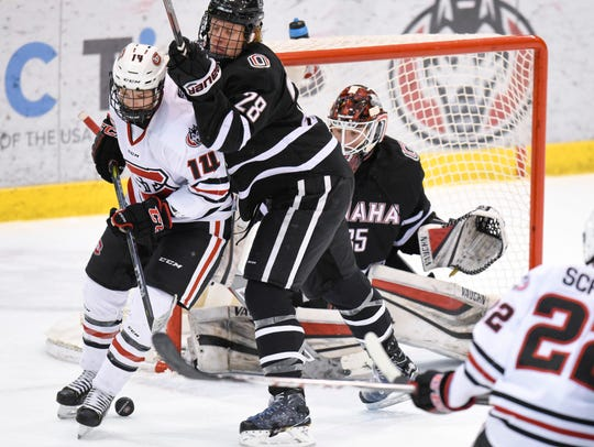 St. Cloud State's Patrick Newell get pushed away from