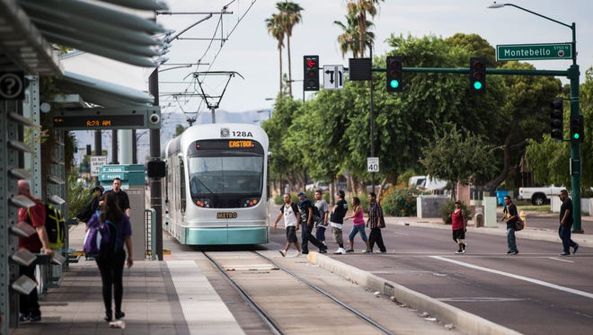 People make their morning commute at the light-rail station stop at 19th Avenue and Montebello in Phoenix on Sept. 1, 2016. With years of light-rail construction woes along 19th Avenue finally over, a coalition is rebranding the area while launching several initiatives to transform it into a safer, more walkable destination.
