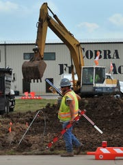Construction workers work at the Wichita Falls Kickapoo Downtown Airport in 2017. The airport is undergoing several concrete airstrip rehabilitation projects. The city is considering bids for fixed-base-operator services at the airport. If the airport went to private operation, the city would still be responsible for major repairs and maintenance of the area.