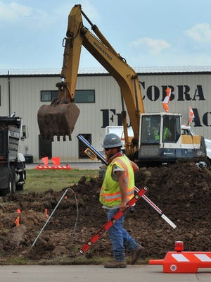 Construction workers work at the Wichita Falls Kickapoo Downtown Airport Friday afternoon.