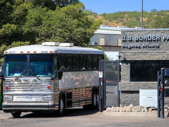 A federal bus leaves the U.S. Customs and Border Protection