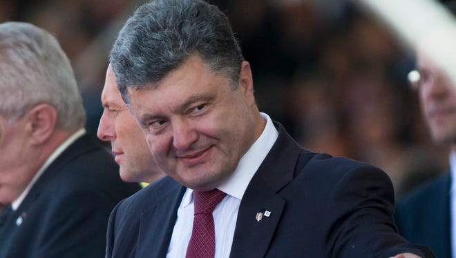 Ukraine's President-elect Petro Poroshenko attends the commemoration of the 70th anniversary of the D-Day in France on June 6, 2014.