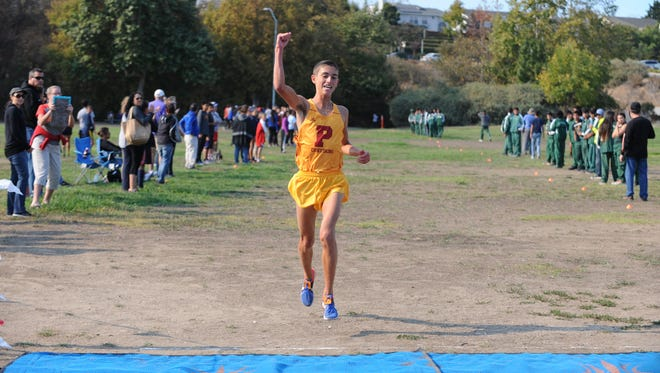 Palma High's Sam Lavorato reaches the finish line at a race earlier this year.
