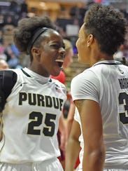 Ae'Rianna Harris, right, is met under the net with