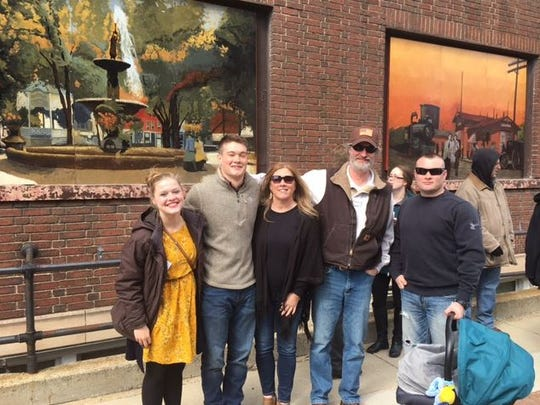 Sam Neer, second from the left, is the artist who painted the downtown Mansfield Historical Postcard Murals now posted at Third and Main streets downtown.