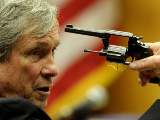 Special Prosecutor Richard Fisher uses the alleged murder weapon to make a point during closing arguments in the murder trial of Raynella Dossett Leath on March 10, 2009, in Knox County Criminal Court.