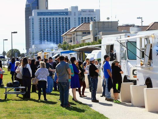 GABE HERNANDEZ/CALLER-TIMES People stand in line as they prepare to order food during the A La Mano food truck event Friday, Jan. 29, 2016, at the North Bayfront Park in Corpus Christi. People had the chance to enjoy the weather, play games and listen to live music.