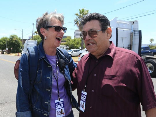 Paulette Kluge, CEO of the Corpus Christi Convention and Visitors Bureau, talks with Abraham Quintanilla Jr. before Fiesta de la Flor on Friday, May 6, 2016.