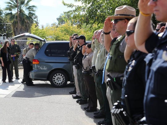 Law enforcement officers pay their respects at the Shasta County Coroner's Office in Redding for Modoc County sheriff's deputy Jack Hopkins, who was shot and killed in October while responding to a family disturbance call outside of Alturas.