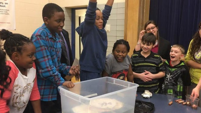 Students build makeshift boats during X STREAM club Feb. 3 at Longfellow Elementary School. The club focuses on science, technology, reading, engineering, art and math.