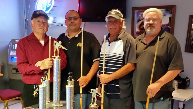 March's Friendship Pool tournament winners are first place (left to right) Andy Nejerres and Joseph Herrera. Second place winners were (middle) Smitty and Doug Beard (far right).
