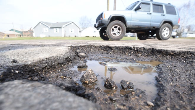 Heavy traffic results in a large pot hole at the intersection of Esley Lane and Grace Street just south of Madison Comprehensive High School.